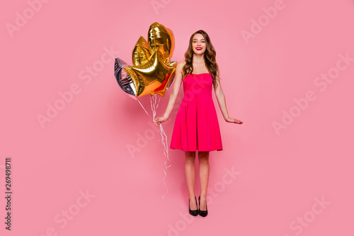 Fototapeta Full length body size photo beautiful amazing she her lady graduation day weekend hand arm hold star shape golden balloons gift present wear colorful formal-wear dress isolated pink bright background obraz na płótnie