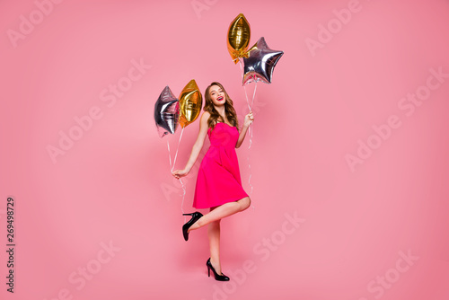 Fototapeta Full length side profile body size photo beautiful she her lady graduation day weekend hand arm star shape golden balloons gift present wear colorful formal-wear dress isolated pink bright background obraz na płótnie