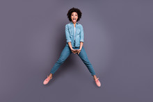 Full Length Body Size Photo Beautiful She Her Dark Skin Excited Lady Jumping High Arms Hands Together Scream Shout Yell Triumphant Champion Wear Casual Jeans Denim Shirt Isolated Grey Background