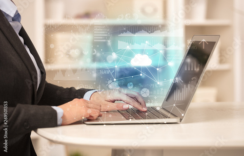 Business woman in homey environment using laptop with cloud technology concept Canvas Print