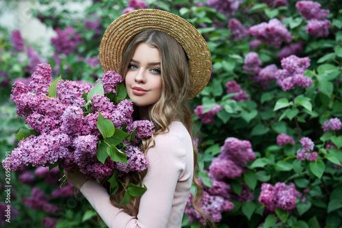Stampa su Tela Beautiful girl in lilac Garden