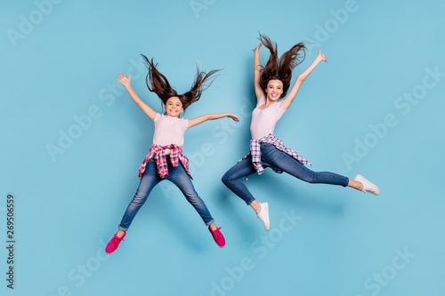 Full length body size view portrait of two nice attractive cheerful cheery careless carefree healthy straight-haired girls having fun rejoicing isolated on bright vivid shine blue turquoise background - 269506559