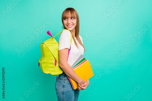 Obraz Close up side profile photo beautiful she her lady look empty space arms hands school colored notebooks modern backpack listen groupmates wear specs casual white t-shirt isolated teal green background - fototapety do salonu