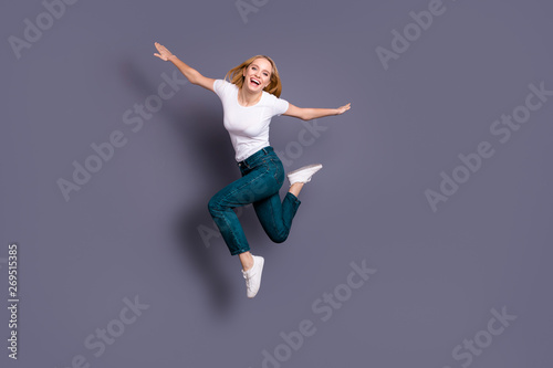 Full length body size view photo of cute charming satisfied lady millennial hands hold excited laughter have free time vacation dressed sneakers youth clothing