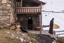 Orthodox Priest In Front Of Ushguli Chapel