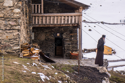 Tela orthodox priest in front of ushguli chapel