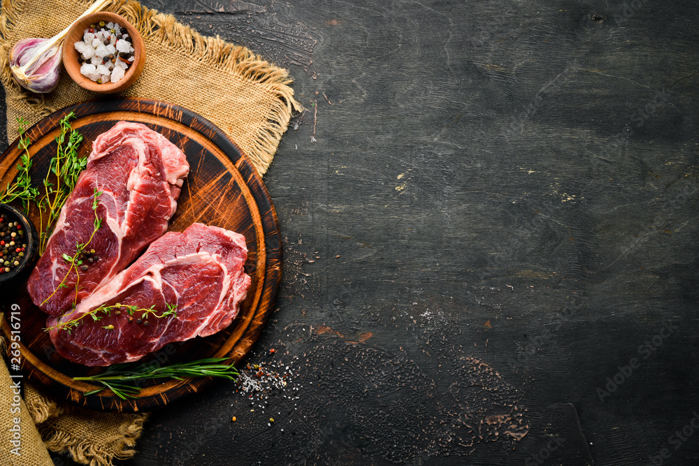 Fototapety, obrazy: Raw marbled meat Black Angus Steak Ribeye. At the aged table. Top view. Free space for your text.