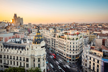 Madrid, Spain, Sunset Over Central Madrid Showing Landmark Buildings On Gran Via Street