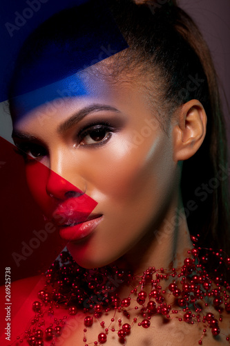 fashionable portrait girl in neon light background. Portrait of beautiful black woman. Futuristic Abstract Blue And Red Neon Light Background - Image
