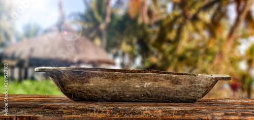 Fotobehang Wooden old plate on worn old table and tropical summer background of palms