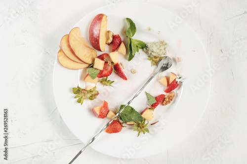 Cuadros en Lienzo leftover food from fruit salad on a white plate