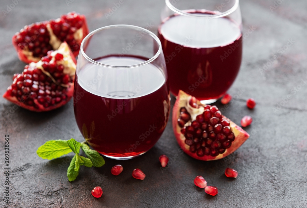 Fototapeta Pomegranate juice with fresh pomegranate fruits