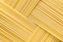 Diagonal Geometric Pattern Of Pasta Bavette. Background Image Of Pasta From Durum Wheat.