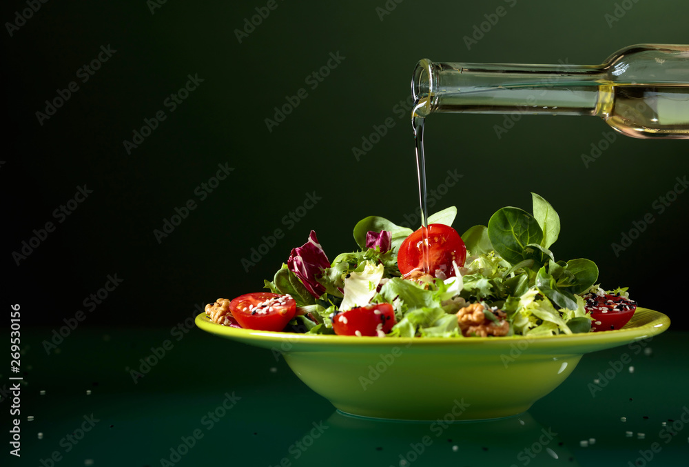 Fototapety, obrazy: Green salad with  tomatoes, sesame and walnuts.