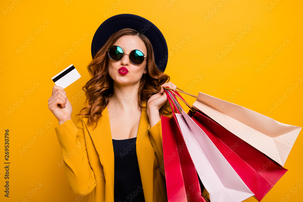 Fototapeta Close up photo beautiful she her model lady hands arms credit plastic card many packs buyer vacation traveler sale discount rich person wear specs formal-wear suit isolated yellow bright background