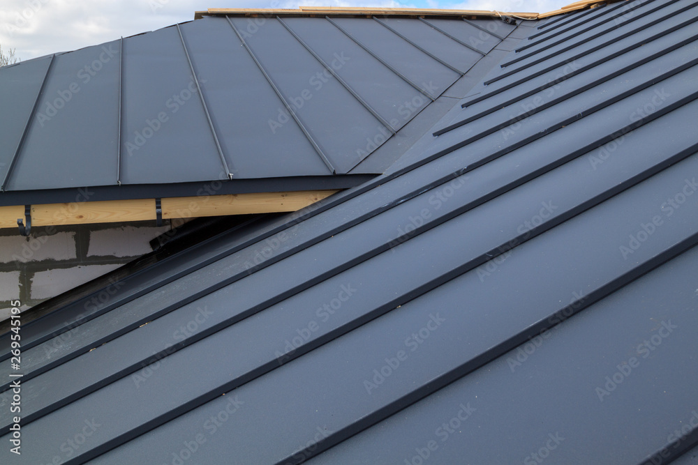 Fototapety, obrazy: close up view of  house under construction with grey folding roof on waterproofing layer