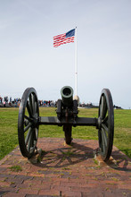 Civil War Cannon And American Flag At Fort Sumter