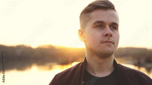 Fotografía  Young thoughtful handsome man enjoying sunlight