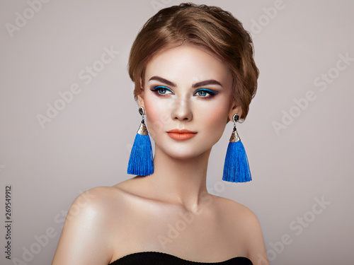 b8f385570ed69 Beautiful Woman with Large Earrings Tassels jewelry Blue color ...