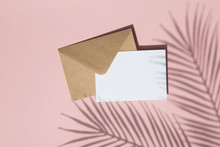 Summer Palm Leaf Shadow On Blank White Card And Brown Paper Envelope Mock Up