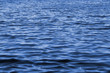 canvas print picture - Wavy blue water surface as a landscape background