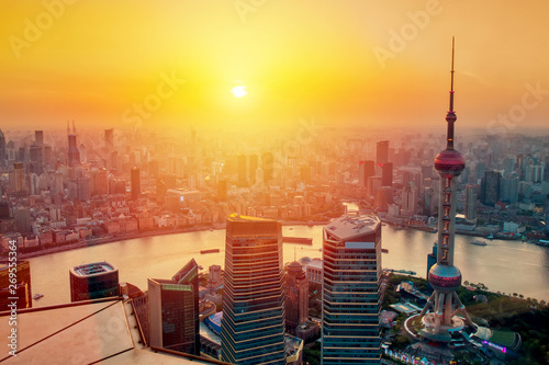 Foto auf Leinwand Shanghai Aerial cityscape of Shanghai at sunset. Panoramic view of Pudong business district skyline from the skyscraper