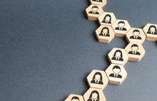 Symbols Of Employees On The Chains Of Hexagons. The Concept Of Business Connections. Team Building, Business Organization And Staff Hierarchy. Human Resources Management, Recruitment. Single Whole.