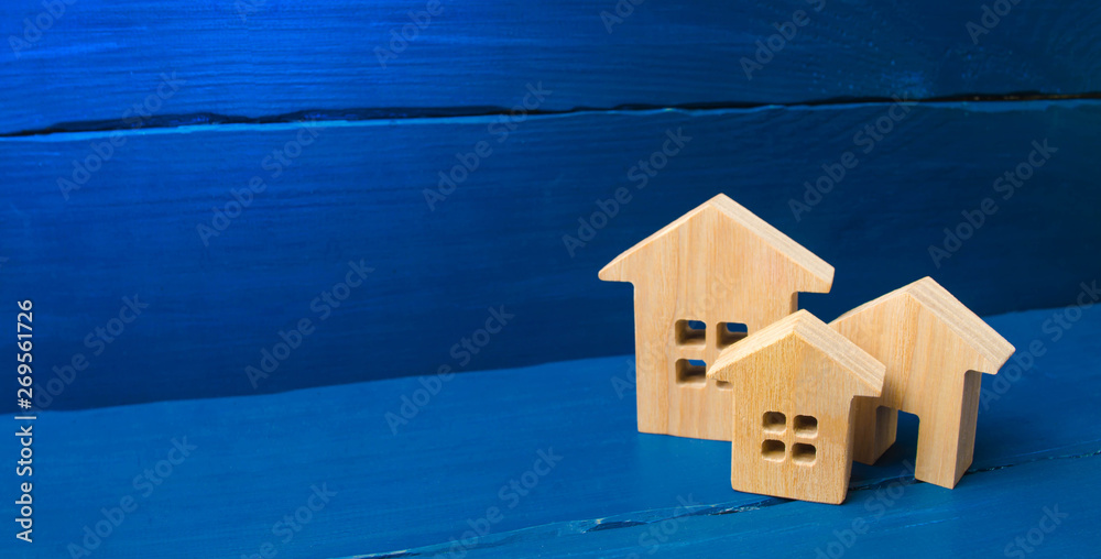 Fototapeta City, settlement. Minimalism. for presentations. real estate market. Three houses on a blue background. Buying and selling of real estate, construction. Apartments. banner, place for text
