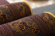 Leinwanddruck Bild - Rolled oriental carpets, close up photo