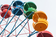 Ferris Wheel. Colorful Empty Cabins