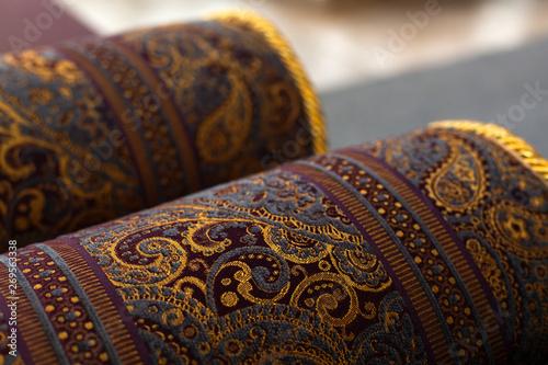 Stampa su Tela  Rolled oriental carpets, close up photo