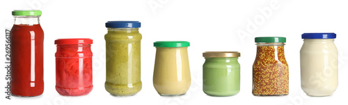 Set of glass jars with different delicious sauces on white background Tableau sur Toile