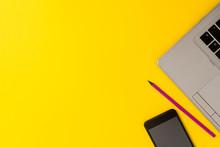 Slim Trendy Silver Open Laptop Pencil Marker Smartphone Colored Background