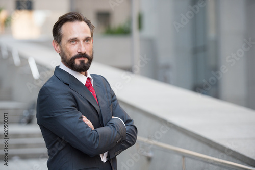 Fotografie, Obraz  Positive entrepreneur looking away with arms crossed