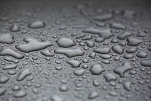 Beautiful Background Texture Of Rain Water Drops On Grey Black Metal Surface. Beautiful Backgrounds.