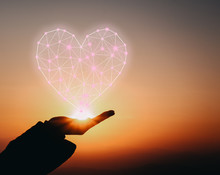 Hand Holding Beautiful Heart Up To The Sky. Love Concept