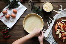 Unrecognizable Woman Making A Apple Pie On A Wooden Table