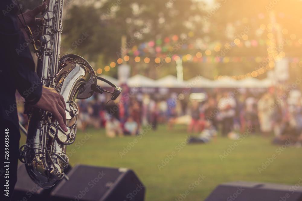 Fototapeta jazz musician playing outdoor concert