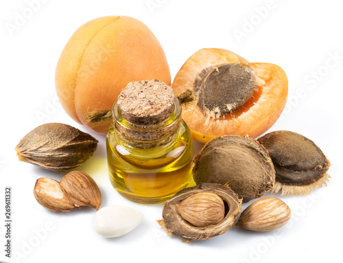 Valokuvatapetti Apricot kernel oil and apricot kernels isolated on the white background
