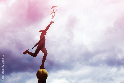 Mercury Hermes god statue running trough clouds in winged sandals, caduceus in hand Wallpaper Mural