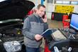 car mechanic using telephone