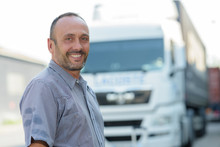 Portrait Of Man Outdoors By Truck