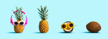 Pineapple And Coconut Wearing Sunglasses On A Solid Color Background