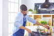 cooking, profession and people concept - male chef cook with sm
