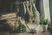 Infusion Bottles, Old Books, Mortar And Hanging Bunches Of Dry Medicinal Herbs. Herbal Medicine. Retro Styled.