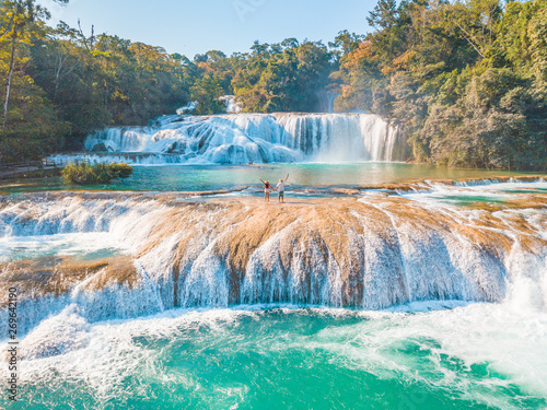 Printed kitchen splashbacks Forest river Couple contemplating the majestic turquoise waterfalls at Agua Azul in Chiapas, Mexico