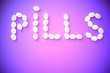 """canvas print picture - The word """"pills"""" consists of medicine pills on a colored background. The concept of pharmacology. Treatment , favorable outcome."""