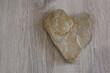 A heart of stone on the wood.
