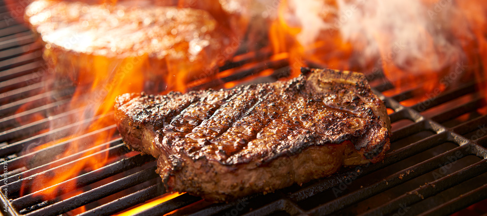 Fototapety, obrazy: rib-eye steaks cooking on flaming grill panorama