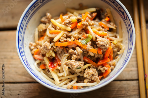 Chinese pork noodle stir fry with egg noodles and vegetables in bowl